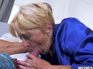 Slutty old lady Malya fucks that chum out of reach of the couch